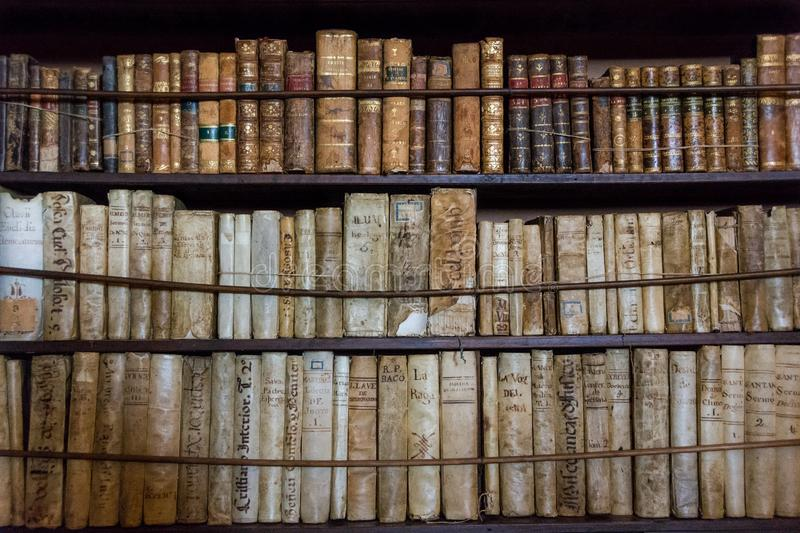 Books in the library in the old monastery Valldemossa Charterhouse in the room of Frederic Chopin and George Sand stock images