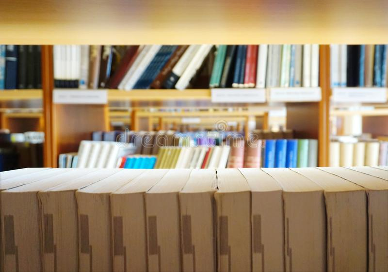 Many different books lined on the library bookshelves stock photography