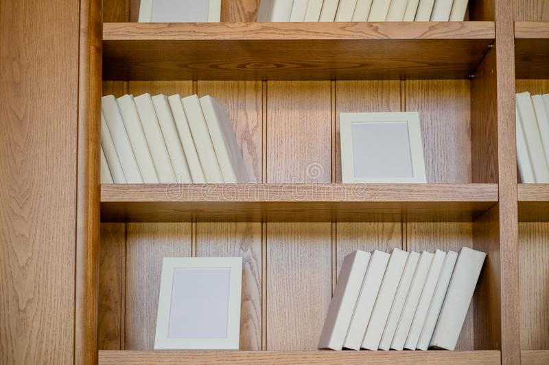 Books. A lot of books with bright white covers isolated on wooden background. Design element, paper and leather texture stock images