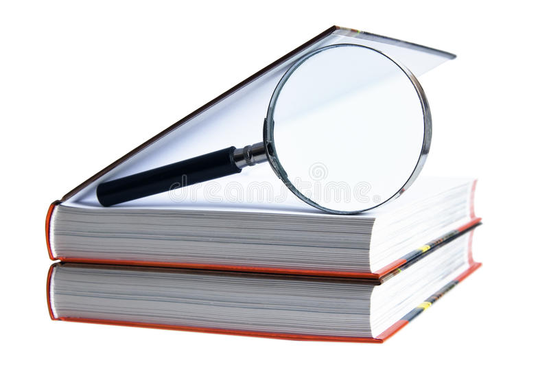 Books with magnifying glass stock photography