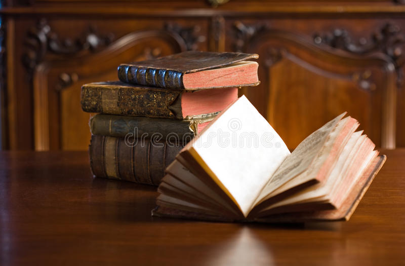 Books of mystery. Shot of mysterious looking beautiful worn antique books stock image