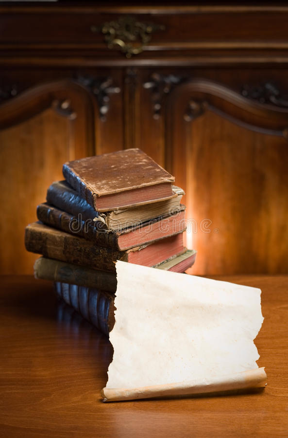 Books of mystery. Shot of mysterious looking beautiful worn antique books stock photography
