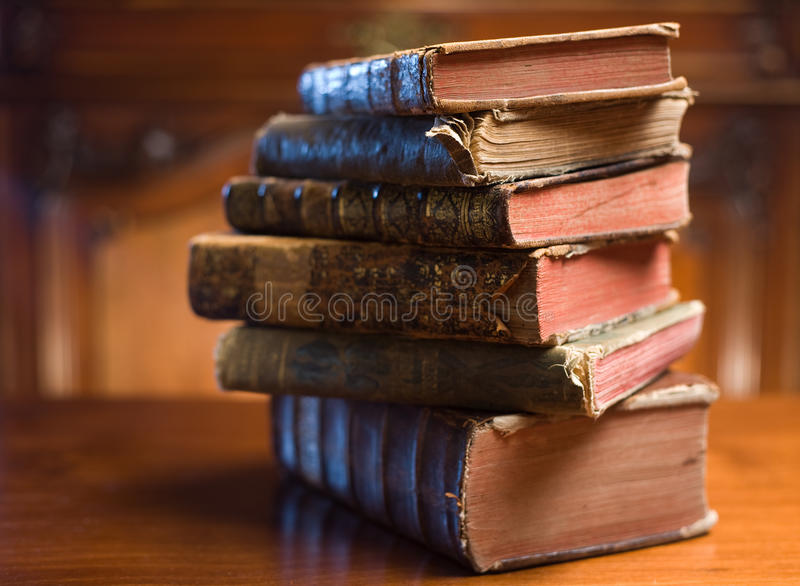 Books of mystery. Shot of mysterious looking beautiful worn antique books stock photos