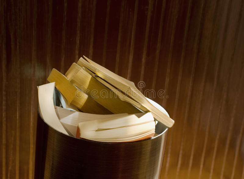 Books In Office Trash Container Stock Photos