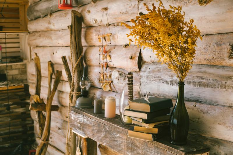 Books and oil lamp on the table. wooden background. vintage.aut royalty free stock image