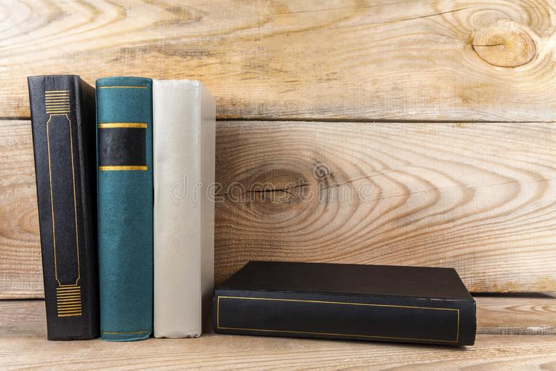 Books on old Bookshelf. Old books on an old, wooden bookshelf royalty free stock photos