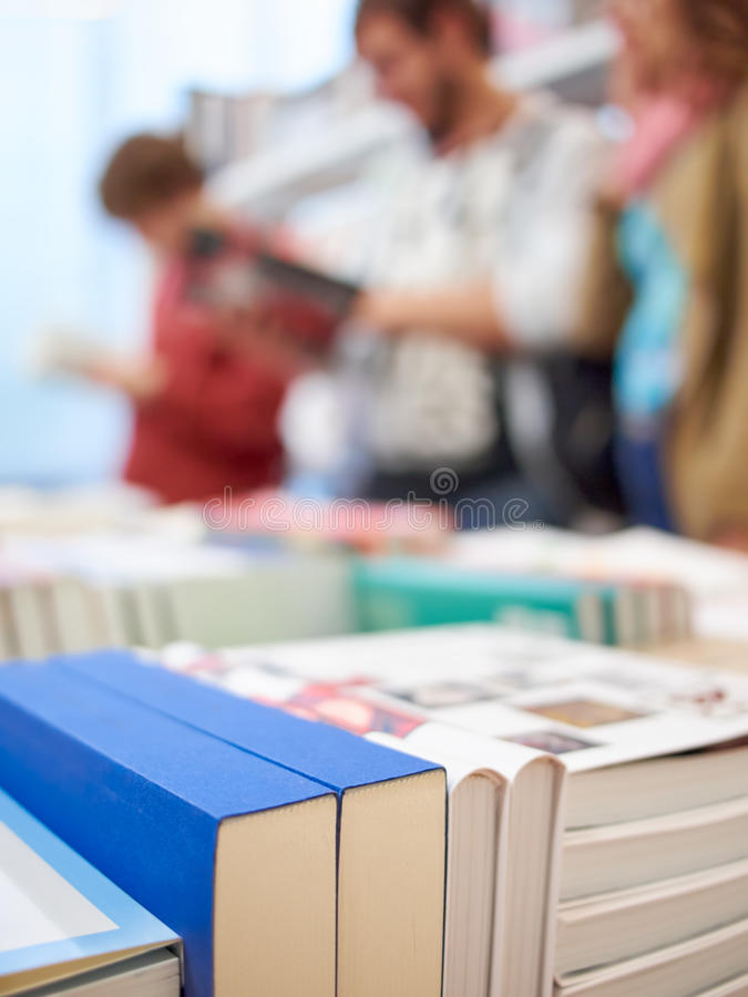 Books and people. In the store stock image