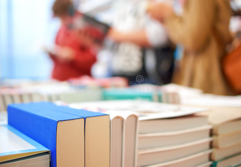 Books and people. In the store stock images