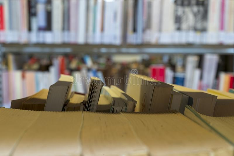 Books on the shelf in a public library, bound, to be used as a background stock photography