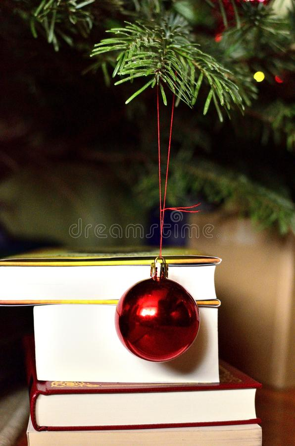 Books and Red Christmas Ornament stock photos