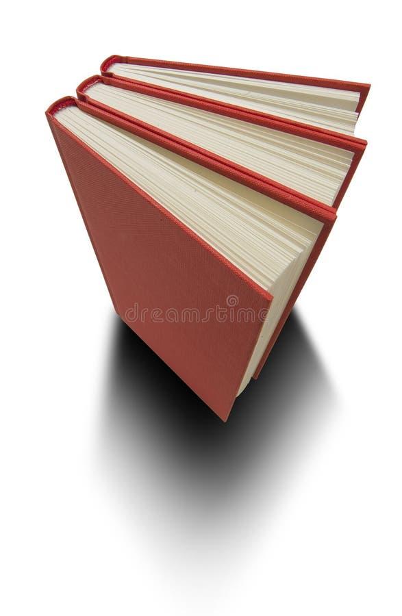 Download Books red tre fotografering för bildbyråer. Bild av volymer - 989479