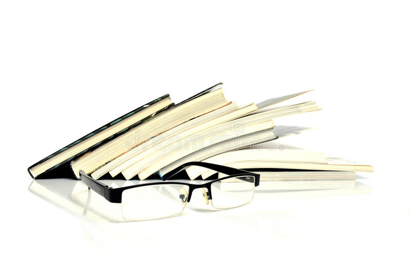 Books. Row of books with nerd glasses in front stock photos