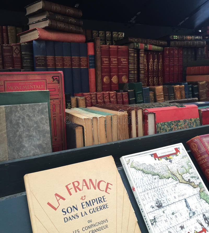 An array of old french literature books on display in a Bouquinistes stock photos