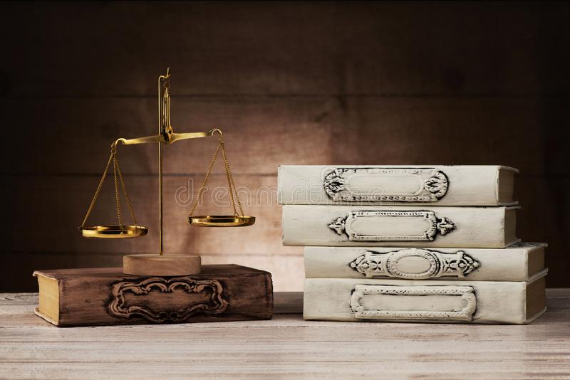 Books and scales of justice stock images