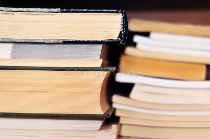 Books on shelf royalty free stock images
