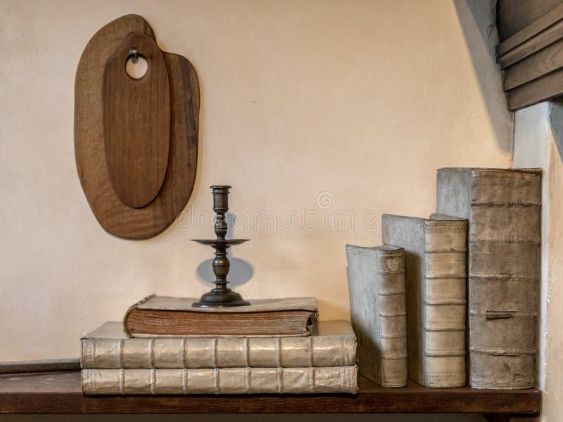 Historic books on shelf stock photos