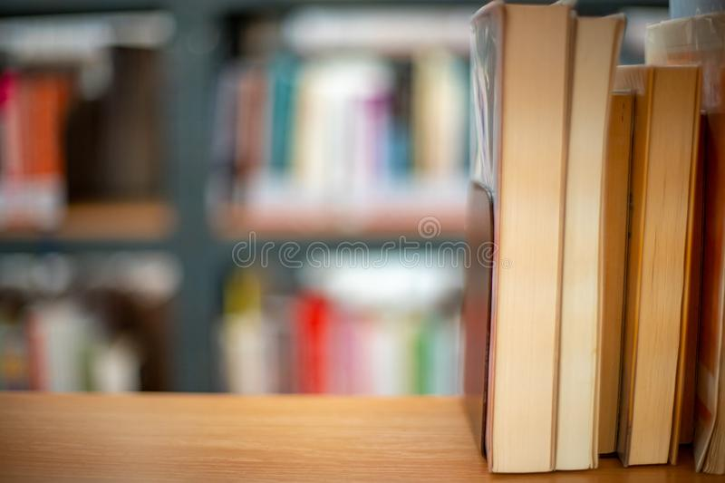 Books on a shelf in a public library ready to rent and to study royalty free stock photos