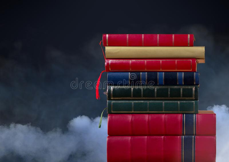 Books stacked by clouds stock photo