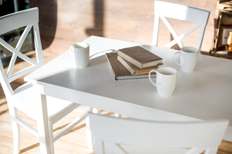 Books stacked on table royalty free stock image