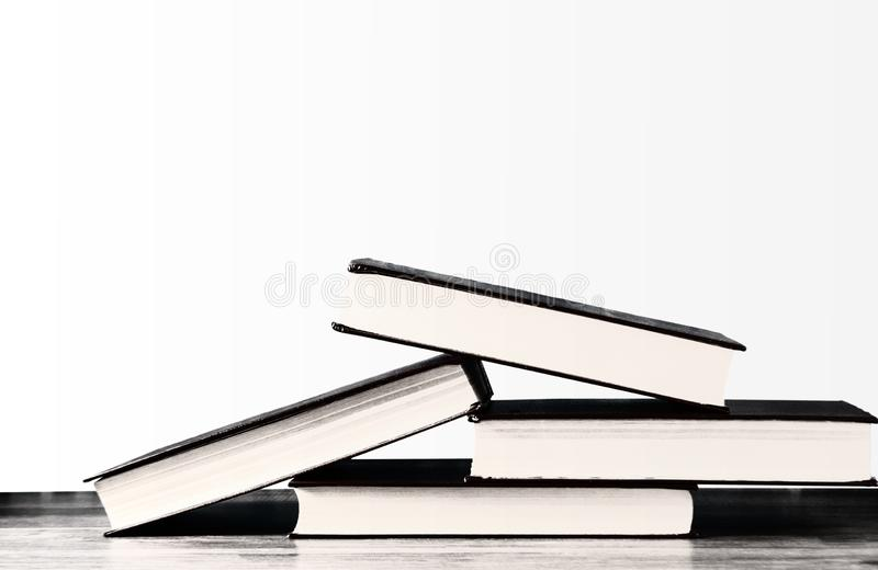 Books stacked on top of each other on a white background. Books stacked on top of each other on an isolated white background royalty free stock photography