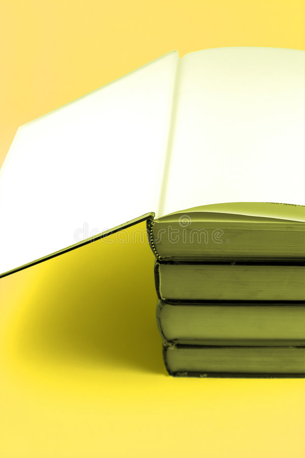 Books Stacked Up - Yellow Background stock images