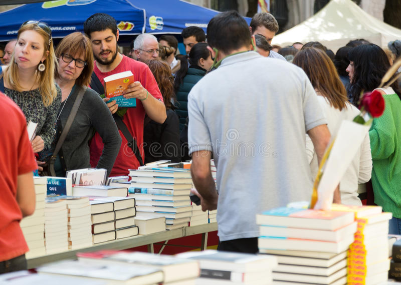 Books on street stalls in Barcelona, Spain. BARCELONA, SPAIN - APRIL 23, 2015: Books on street stalls in Barcelona, Spain. Saint George is saint patron of city stock photos