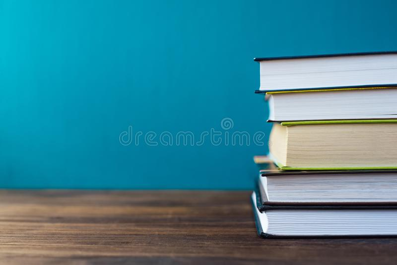 Books on table in front of chalk board royalty free stock images