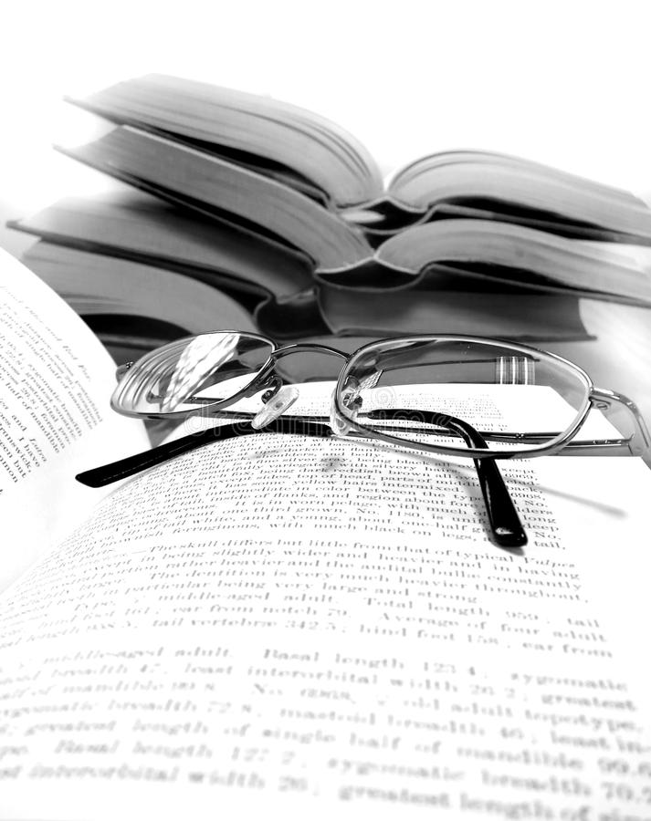 Books on Table in Library stock images