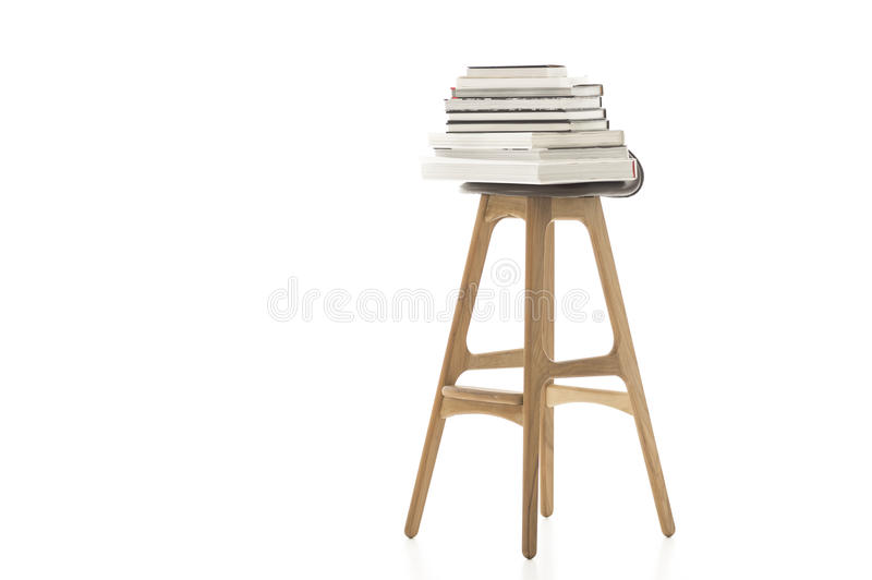 Books on Top of Wooden Leg Chair stock photos