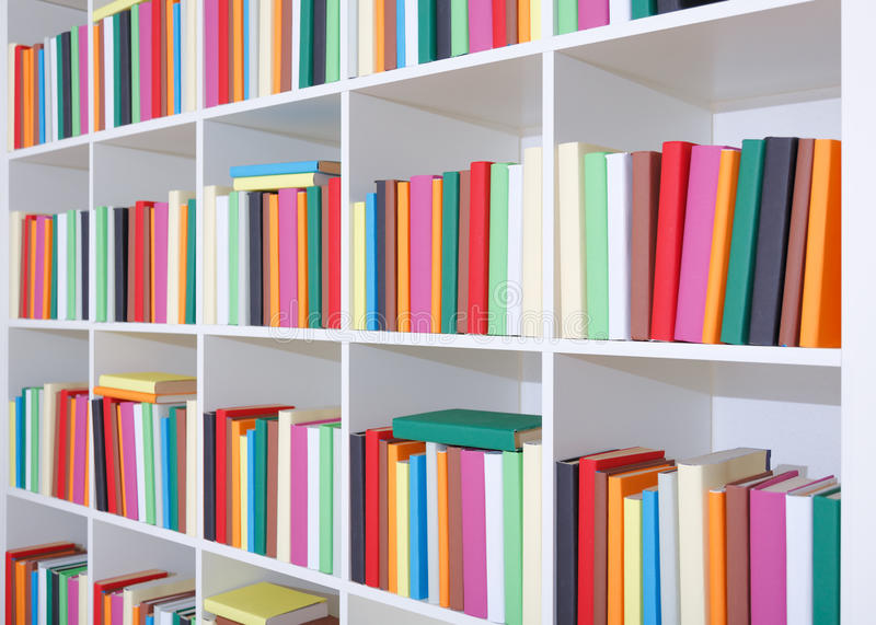 Books On A White Shelf, Stack Of Colorful Books Stock Image - Image ...