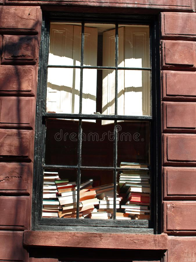 Books in a window royalty free stock photo