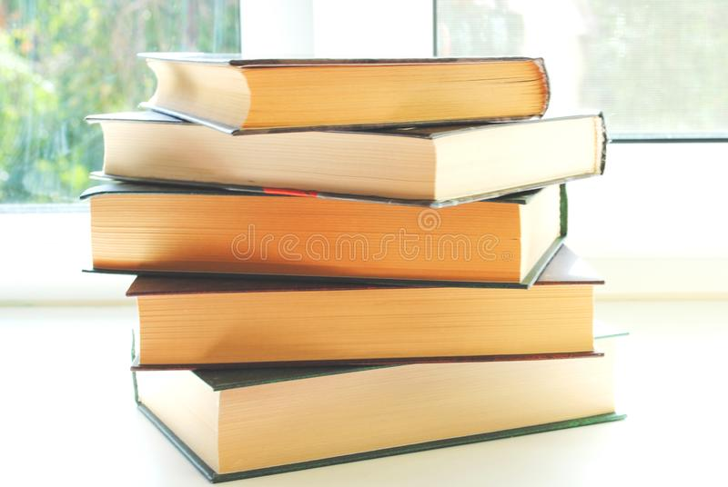 Books on the window sill. Summer royalty free stock image