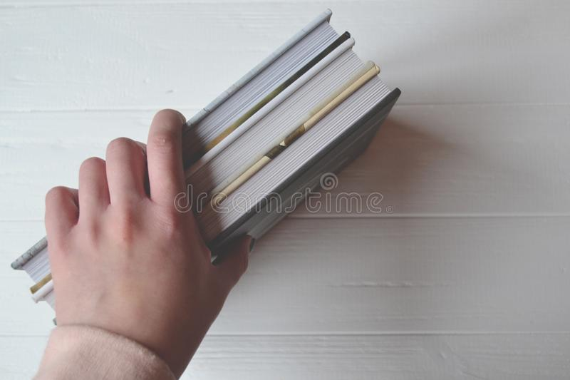 Books in the woman hand on the white background. stock images