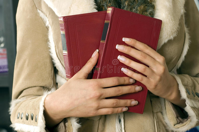 Books in the women hands royalty free stock image
