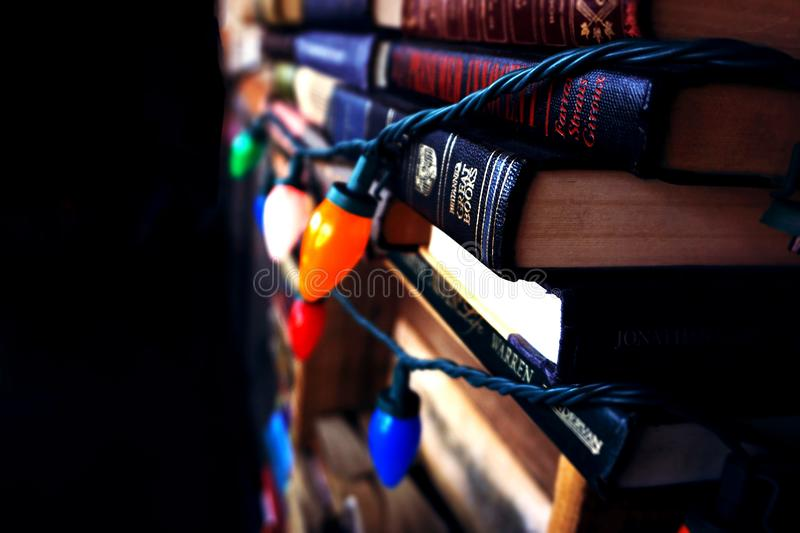 Books Wrapped In Christmas Lights royalty free stock photo