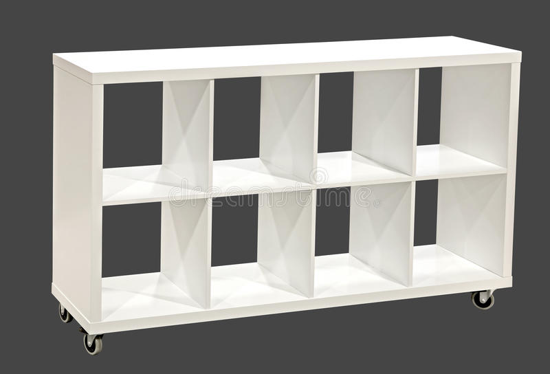 Bookshelf. White bookshelf isolated on gray. Clipping path royalty free stock images
