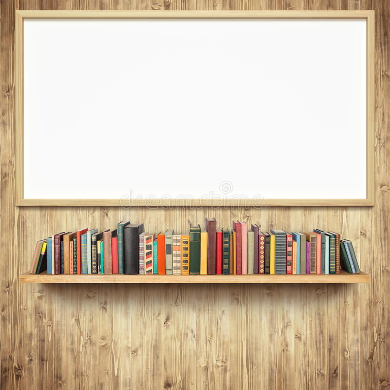 Bookshelf and empty white board. On wooden wall stock image