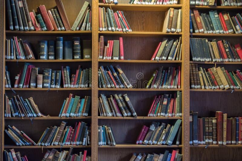 Bookshelf with Turkish Ottoman handwriting books stock photo