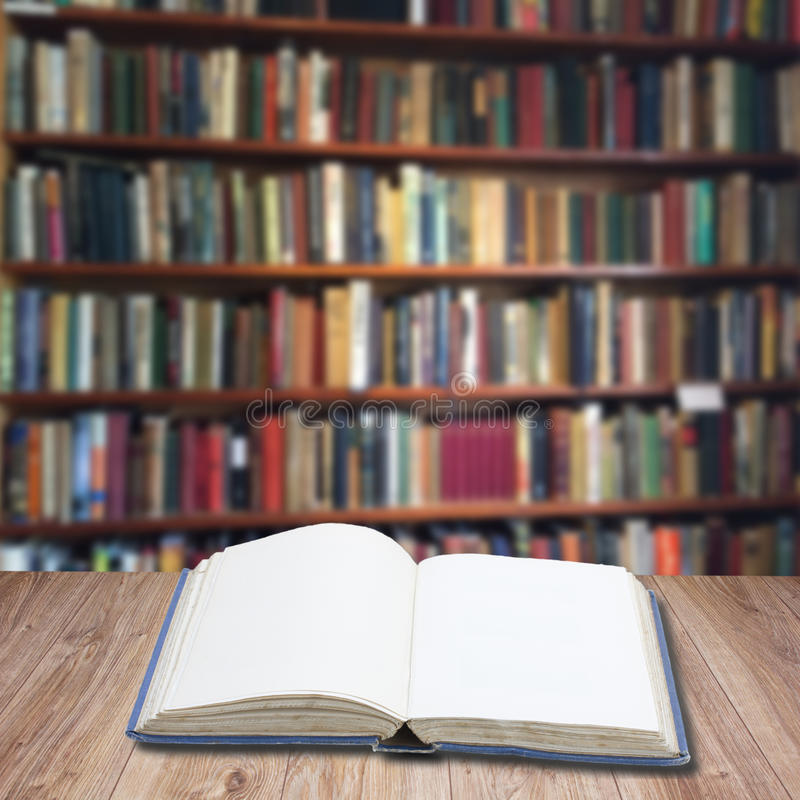Bookshelf. Wooden bookshelf with open empty book, copy space on pages royalty free stock image