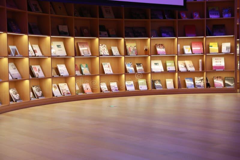 Bookshop interior in china , bookstore interior. Modern bookstore interior with books on shelves in shanghai china stock photos