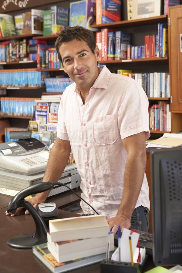 bookshop male proprietor royaltyfria foton