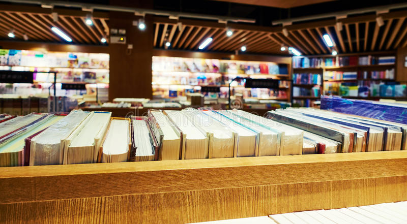 Bookstore. Interior of bookstore, bookshop. Book store with books on bookshelf on sale. Modern book retail shop royalty free stock image