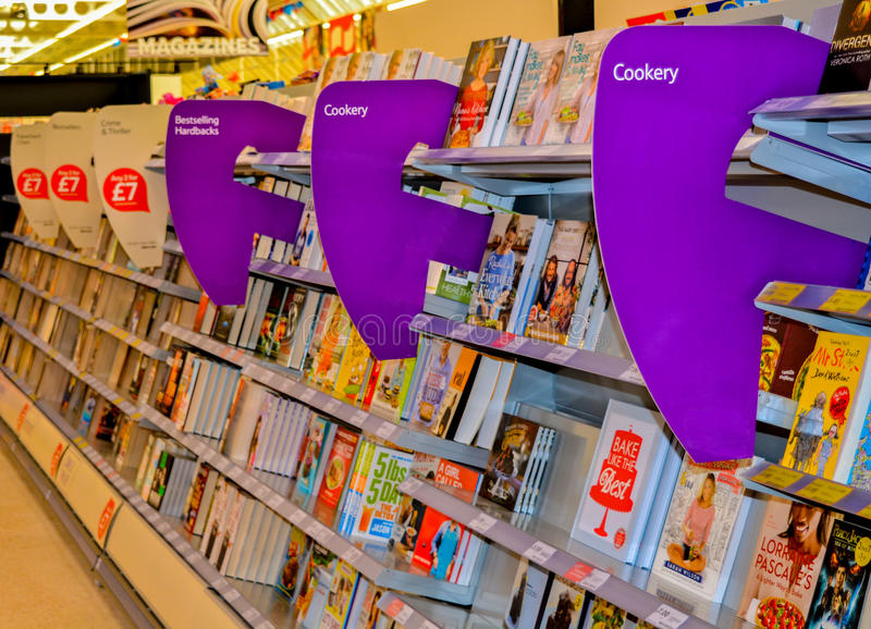 At the bookstore. Stacks of books with signage dividers in the supermarket stock images