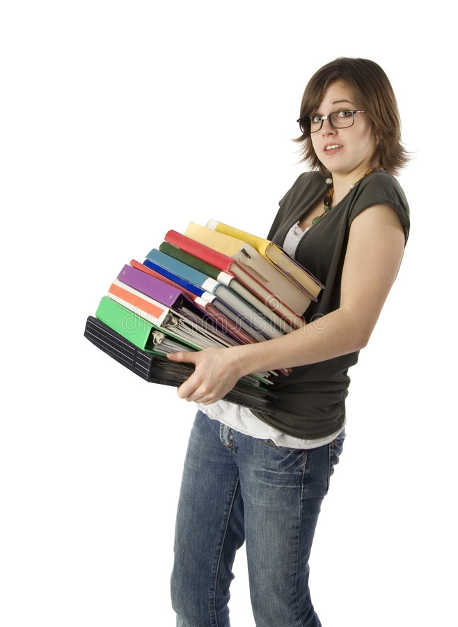 Bookworm. Teenage girl holding large stack of books stock photography