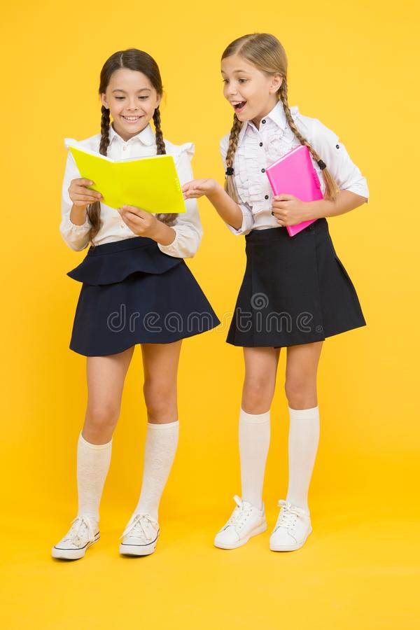 Bookworm. little girls in school uniform. dictionary notebook. Get information. reading story. childrens literature. Kids learning grammar. back to school stock image