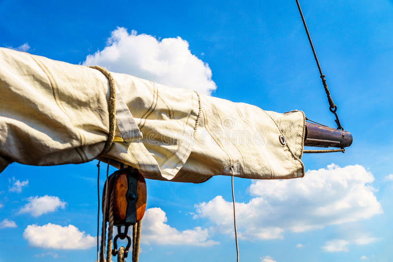 Boom, Block and Tackle, and Sail of a Historic Botter Boat in the Harbor of Bunschoten-Spakenburg. In the Netherlands stock image