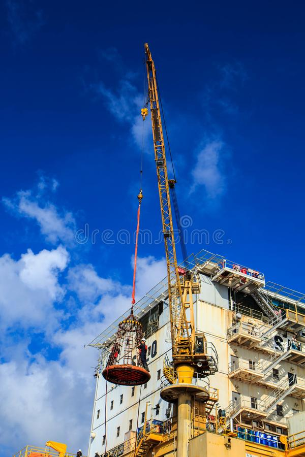 Boom lift people. Offshore oil into the cargo tanker royalty free stock photos