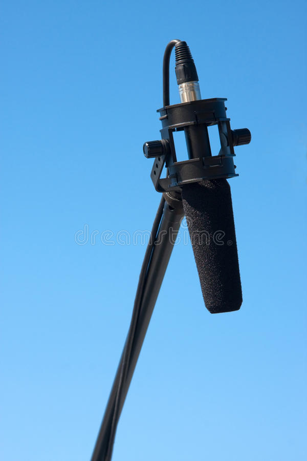 Boom Mike. With foam windscreen using an xlr plug against a clear blue sky background stock photos