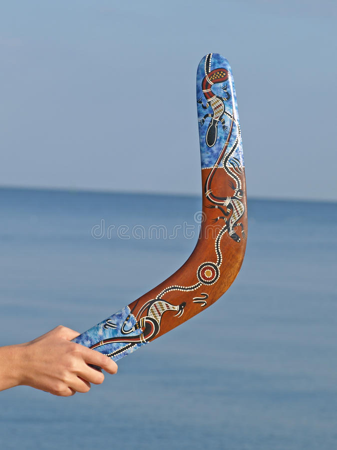 Free Boomerang In Womens Hand Against Of The Blue Sea. Stock Photos - 16284133