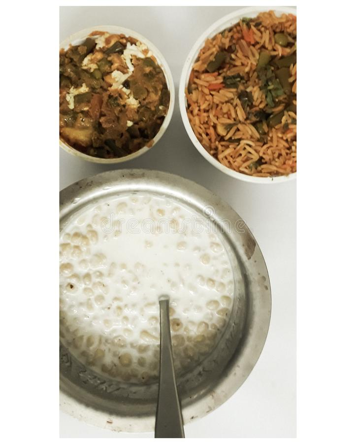 Mixed rice dish called vegetable biryani served with boondi raita and mixed vegetable. Boondi Raita is served as a side dish to be eaten with main course dishes royalty free stock photography